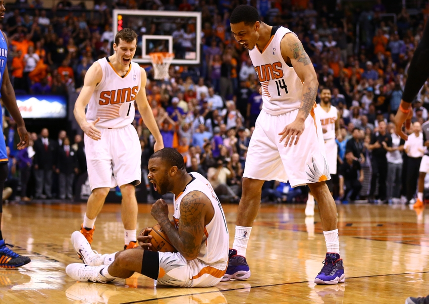 Apr 6, 2014; Phoenix, AZ, USA; Phoenix Suns forward P.J. Tucker (on ground) celebrates with teammates Goran Dragic (1) and Gerald Green (14) after being fouled in the fourth quarter against the Oklahoma City Thunder at US Airways Center. The Suns defeated the Thunder 122-115. Mandatory Credit: Mark J. Rebilas-USA TODAY Sports