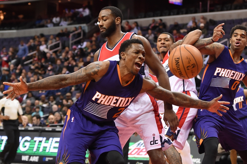 Nov 21, 2016; Washington, DC, USA; Phoenix Suns guard Eric Bledsoe (2) reacts after loosing control of the ball as Washington Wizards guard John Wall (2) defends during the third quarter at Verizon Center. Washington Wizards defeated Phoenix Suns 106-101. Mandatory Credit: Tommy Gilligan-USA TODAY Sports