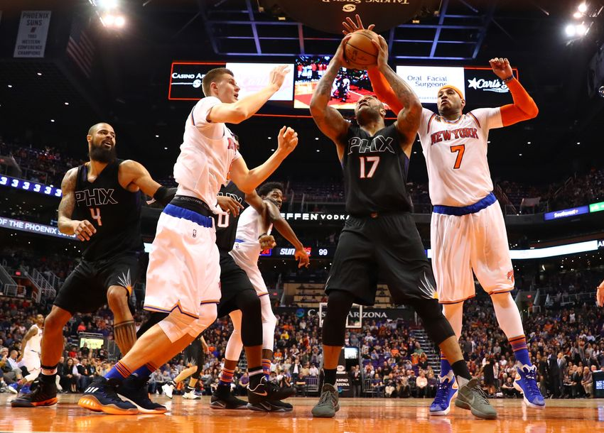 9746443-carmelo-anthony-p.j.-tucker-kristaps-porzingis-nba-new-york-knicks-phoenix-suns