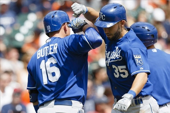 Aug 16, 2013; Detroit, MI, USA; Kansas City Royals first baseman Eric Hosmer (35) receives congratulations from designated hitter Billy Butler (16) after hitting a home run fourth inning against the Detroit Tigers at Comerica Park. Mandatory Credit: Rick Osentoski-USA TODAY Sports