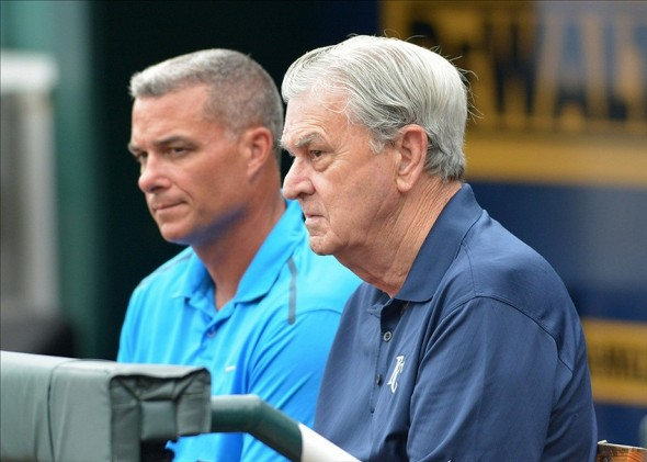 Jul 20, 2013; Kansas City, MO, USA; Kansas City Royals general manager Dayton Moore (left) and owner David Glass watch the Detroit Tigers during batting practice before the game at Kauffman Stadium. Mandatory Credit: Denny Medley-USA TODAY Sports