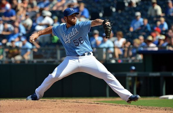 Aug 25, 2013; Kansas City, MO, USA; Kansas City Royals pitcher Greg Holland (56) delivers a pitch against the Washington Nationals during the ninth inning at Kauffman Stadium. Kansas City beat Washington 6-4. Mandatory Credit: Peter G. Aiken-USA TODAY Sports