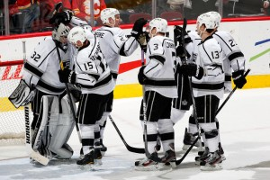CALGARY, CANADA - JANUARY 14: Jonathan Quick #32 of the Los Angeles Kings is congratulated by teammates after a 4-1 win against the Calgary Flames on January 14, 2012 at the Scotiabank Saddledome in Calgary, Alberta, Canada. (Photo by Gerry Thomas/NHLI via Getty Images)
