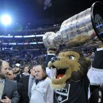 Jun 13, 2014; Los Angeles, CA, USA; The Los Angeles Kings mascot Bailey hoists the Stanley Cup after defeating the New York Rangers in second overtime during game five of the 2014 Stanley Cup Final at Staples Center. Mandatory Credit: Gary Vasquez-USA TODAY Sports
