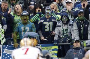 Jan 19, 2014; Seattle, WA, USA; Seattle Seahawks fans yell as San Francisco 49ers quarterback Colin Kaepernick (7) waits for the snap during the first half of the 2013 NFC Championship football game at CenturyLink Field. Mandatory Credit: Joe Nicholson-USA TODAY Sports