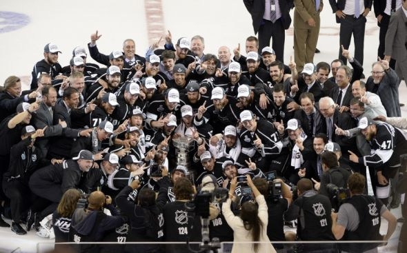 Jun 13, 2014; Los Angeles, CA, USA; The Los Angeles Kings pose for a team photo with the Stanley Cup after defeating the New York Rangers in the second overtime period in game five of the 2014 Stanley Cup Final at Staples Center. Mandatory Credit: Richard Mackson-USA TODAY Sports