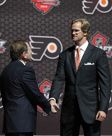 Jun 30, 2013; Newark, NJ, USA; Philadelphia Flyers defenseman Chris Pronger (right) shakes hands with NHL commissioner Gary Bettman during the 2013 NHL Draft at the Prudential Center. Mandatory Credit: Ed Mulholland-USA TODAY Sports