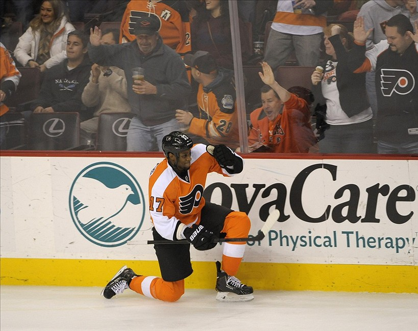 Dec 17, 2013; Philadelphia, PA, USA; Philadelphia Flyers right wing Wayne Simmonds (17) celebrates his goal against the Washington Capitals during the third period at Wells Fargo Center. The Flyers defeated the Capitals, 5-2. Mandatory Credit: Eric Hartline-USA TODAY Sports