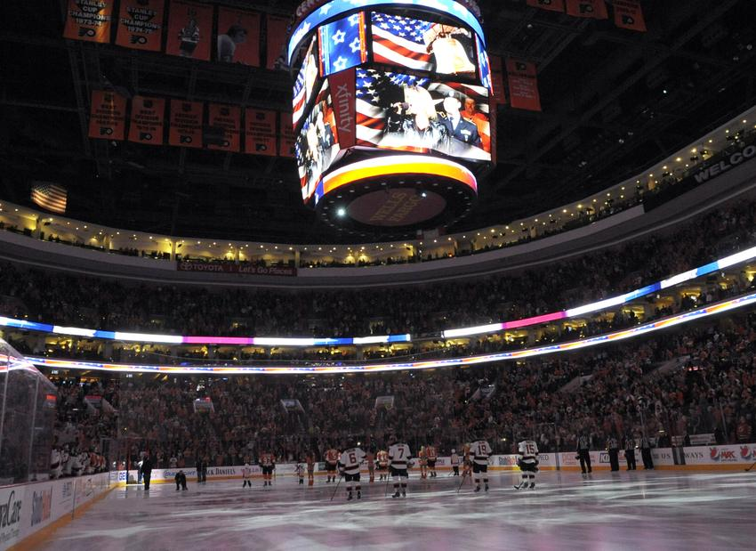 Mar 11, 2014; Philadelphia, PA, USA; Philadelphia Flyers and New Jersey Devils during the national anthem before game at Wells Fargo Center. The Devils defeated the Flyers, 2-1. Mandatory Credit: Eric Hartline-USA TODAY Sports