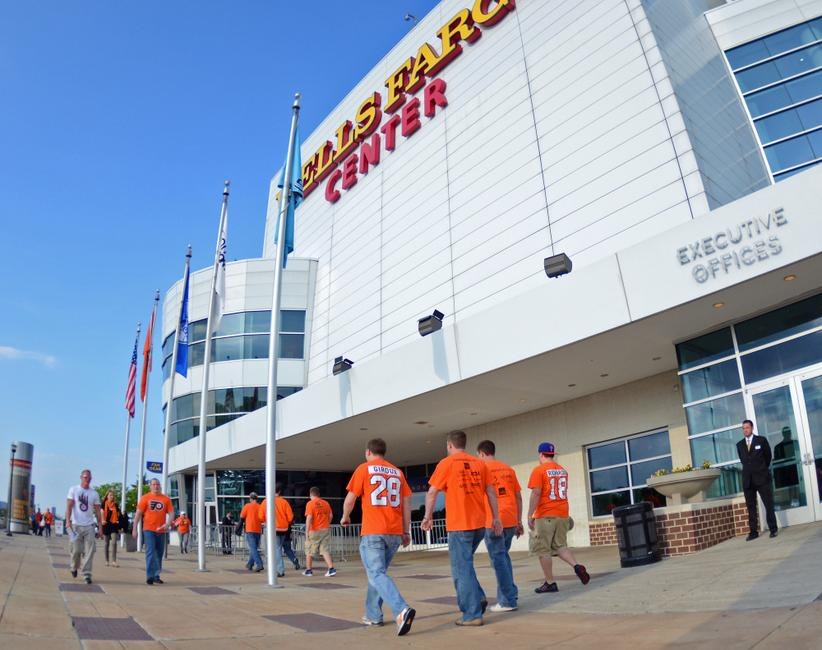 May 1, 2012; Philadelphia, PA, USA; Philadelphia Flyers fans walk towards the Wells Fargo Center prior to the start of game two of the 2012 Eastern Conference semifinals against the New Jersey Devils. Mandatory Credit: Eric Hartline-USA TODAY Sports