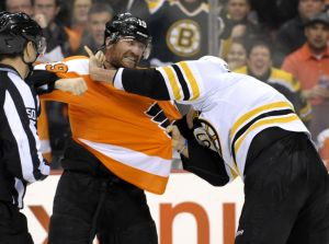 Jan 25, 2014; Philadelphia, PA, USA; Boston Bruins defenseman Johnny Boychuk (55) and Philadelphia Flyers left wing Scott Hartnell (19) fight during the second period at Wells Fargo Center. Mandatory Credit: Eric Hartline-USA TODAY Sports