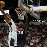 Jul 25, 2013; Las Vegas, NV, USA; USA White Team guard Paul George pulls down a defensive rebound away from USA Blue Team center DeMarcus Cousins during the 2013 USA Basketball Showcase at the Thomas and Mack Center. Mandatory Credit: Stephen R. Sylvanie-USA TODAY Sports