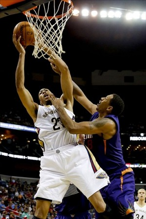 Nov 5, 2013; New Orleans, LA, USA; New Orleans Pelicans power forward Anthony Davis (23) catches a pass over the head of Phoenix Suns power forward Channing Frye (8) during the second quarter at New Orleans Arena. Mandatory Credit: Derick E. Hingle-USA TODAY Sports