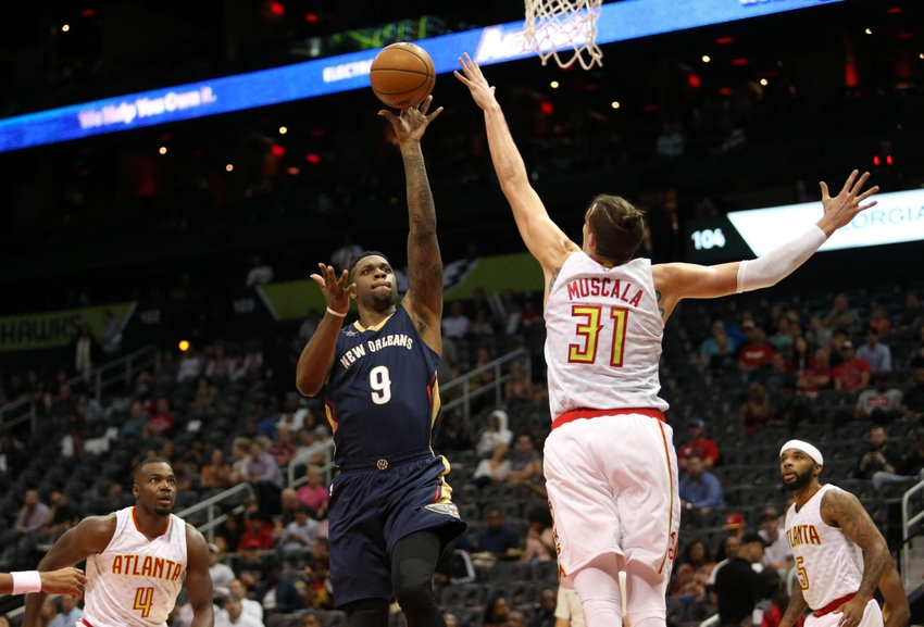 9616755-terrence-jones-mike-muscala-nba-preseason-new-orleans-pelicans-atlanta-hawks