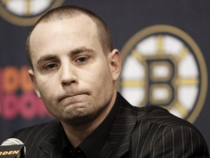 Boston Bruins center Marc Savard listens to a reporters' question during his first news conference since suffering a concussion on March 7, 2010
