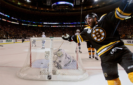 Boston Bruins centre David Krejci celebrates after scoring on Vancouver Canucks goaltender Roberto Luongo during Game 3 of the Stanley Cup final at TD Garden in Boston, Massachusetts, on June 6, 2011. Photo by Bruce Bennett, Getty Images
