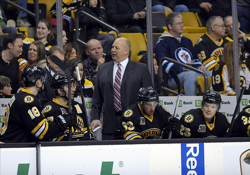 Jan 4, 2014; Boston, MA, USA; Boston Bruins head coach Claude Julien talks to his players on the bench during the second period against the Winnipeg Jets at TD Banknorth Garden. Mandatory Credit: Bob DeChiara-USA TODAY Sports
