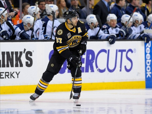 Jan 4, 2014; Boston, MA, USA; Boston Bruins center Patrice Bergeron (37) looks for an open teammate during the first period against the Winnipeg Jets at TD Banknorth Garden. Mandatory Credit: Bob DeChiara-USA TODAY Sports