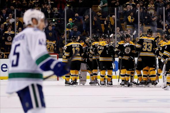 Bruins celebrate victory over Canucks