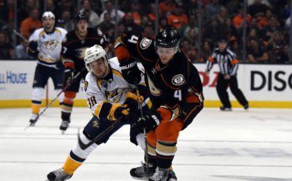 20a41aff6 Apr 27, 2016; Anaheim, CA, USA; Anaheim Ducks defenseman Cam Fowler (4) and  Nashville Predators right wing Viktor Arvidsson (38) battle for the puck in  game ...