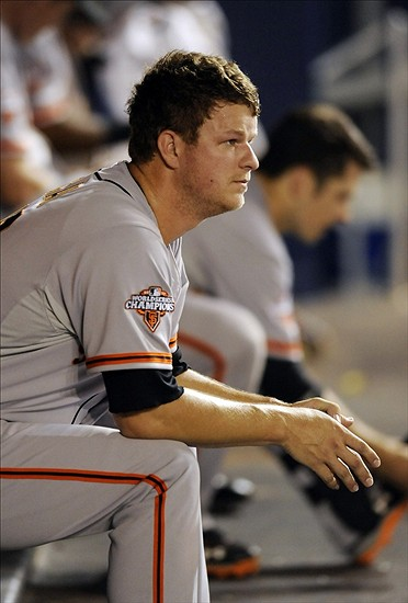Aug 17, 2013; Miami, FL, USA; San Francisco Giants starting pitcher Matt Cain (18) sits in the dugout during the fifth inning against the Miami Marlins at Marlins Park. Mandatory Credit: Steve Mitchell-USA TODAY Sports