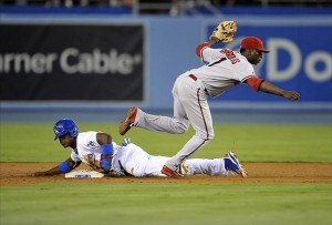 Yasiel Puig steals his 11th base of the season in the second inning. Photo: Gary A. Vasquez-USA TODAY Sports