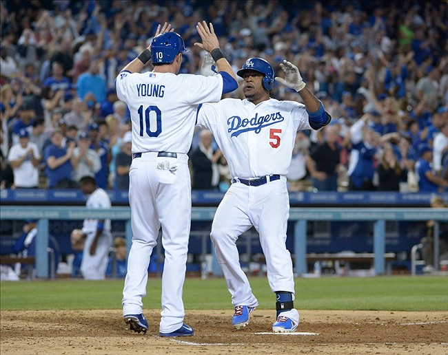 Sep 13, 2013; Los Angeles, CA, USA; Los Angeles Dodgers third baseman Juan Uribe (5) celebrates with first baseman Michael Young (10) after hitting a two-run home run in the sixth inning against the San Francisco Giants at Dodger Stadium. Mandatory Credit: Kirby Lee-USA TODAY Sports