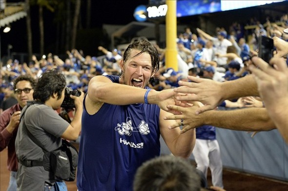 Kershaw does a victory lap after the Dodger's 4-3 victory over the Braves in game 4 of the NLDS-Richard Mackson-USA TODAY Sports