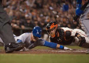 Sep 26, 2013; San Francisco, CA, USA; San Francisco Giants catcher Buster Posey (28, right) tags out Los Angeles Dodgers catcher Tim Federowicz (18, left) as he slides into home plate during the second inning at AT