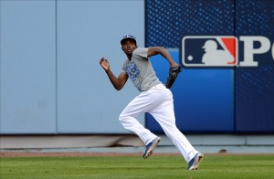 Dee Gordon shagging outfield balls. Photo: Jayne Kamin-Oncea-USA TODAY Sports
