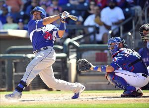 March 8, 2014; Surprise, AZ, USA; Los Angeles Dodgers catcher Miguel Olivo (30) at bat in the second inning against the Texas Rangers at Surprise Stadium. Mandatory Credit: Gary A. Vasquez-USA TODAY Sports