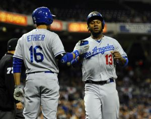 Apr 2, 2014; San Diego, CA, USA; Los Angeles Dodgers shortstop Hanley Ramirez (13) is congratulated by center fielder Andre Ethier (16) after scoring during the first inning against the San Diego Padres at Petco Park. Mandatory Credit: Christopher Hanewinckel-USA TODAY Sports