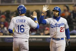 Apr 30, 2014; Minneapolis, MN, USA; Los Angeles Dodgers designated hitter Andre Ethier (16) and center fielder Matt Kemp (27) celebrate after scoring runs in the seventh inning against the Minnesota Twins at Target Field. Mandatory Credit: Jesse Johnson-USA TODAY Sports