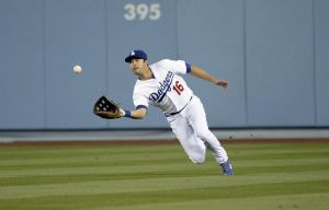 Apr 18, 2014; Los Angeles, CA, USA; Los Angeles Dodgers center fielder Andre Ethier (16) makes a catch against the Arizona Diamondbacks during the eleventh inning at Dodger Stadium. Mandatory Credit: Richard Mackson-USA TODAY Sports
