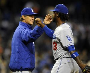Apr 2, 2014; San Diego, CA, USA; Los Angeles Dodgers manager Don Mattingly (8) congratulates shortstop Hanley Ramirez (13) after a win against the San Diego Padres at Petco Park. The Dodgers won 5-1. Mandatory Credit: Christopher Hanewinckel-USA TODAY Sports
