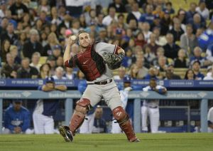 Apr 18, 2014; Los Angeles, CA, USA; Arizona Diamondbacks catcher Miguel Montero (26) throws to first base for an out against Los Angeles Dodgers shortstop Hanley Ramirez (13) during the eighth inning at Dodger Stadium. Mandatory Credit: Richard Mackson-USA TODAY Sports