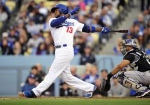 April 26, 2014; Los Angeles, CA, USA; Los Angeles Dodgers shortstop Hanley Ramirez (13) hits an RBI single in the third inning against the Colorado Rockies at Dodger Stadium. Mandatory Credit: Gary Vasquez-USA TODAY Sports