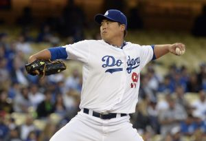 Apr 22, 2014; Los Angeles, CA, USA; Los Angeles Dodgers starting pitcher Hyun-Jin Ryu throws a pitch against the Philadelphia Phillies during the game at Dodger Stadium. Mandatory Credit: Richard Mackson-USA TODAY Sports