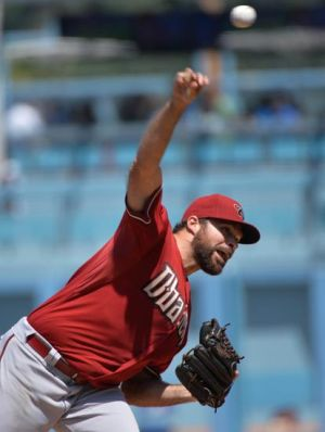 Apr 20, 2014; Los Angeles, CA, USA; Arizona Diamondbacks relief pitcher Josh Collmenter (55) throws in the fourth inning against the Los Angeles Dodgers at Dodger Stadium. Mandatory Credit: Robert Hanashiro-USA TODAY Sports