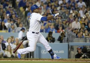 Apr 24, 2014; Los Angeles, CA, USA; Los Angeles Dodgers third baseman Juan Uribe hits a two-run home run against the Philadelphia Phillies in the fourth inning during the game at Dodger Stadium. Mandatory Credit: Richard Mackson-USA TODAY Sports