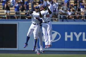 Apr 20, 2014; Los Angeles, CA, USA;Los Angeles Dodgers left fielder Carl Crawford (3) celebrates with center fielder Matt Kemp (27), and right fielder Yasiel Puig (66) after defeating the Arizona Diamondbacks 4-1 at Dodger Stadium. Mandatory Credit: Robert Hanashiro-USA TODAY Sports