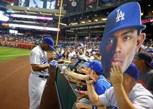 Wow that's one big Puig sign-Mark J. Rebilas-USA TODAY Sports