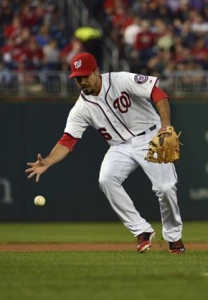 May 6, 2014; Washington, DC, USA; Washington Nationals third baseman Anthony Rendon (6) make a bare hand grab during the third inning against the Los Angeles Dodgers at Nationals Park. Mandatory Credit: Tommy Gilligan-USA TODAY Sports