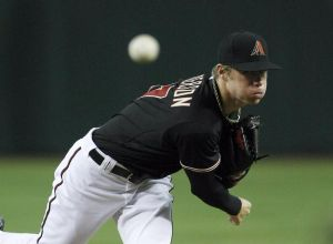May 17, 2014; Phoenix, AZ, USA; Arizona Diamondbacks starting pitcher Chase Anderson (57) throws in the first inning against the Los Angeles Dodgers at Chase Field. Mandatory Credit: Rick Scuteri-USA TODAY Sports