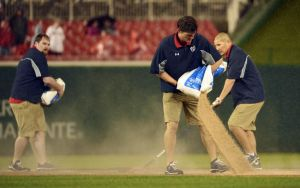 May 5, 2014; Washington, DC, USA; Washington Nationals grounds crew attempts to dry the field during the fourth inning against the Los Angeles Dodgers at Nationals Park. Mandatory Credit: Tommy Gilligan-USA TODAY Sports