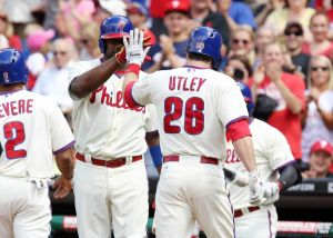May 24, 2014; Philadelphia, PA, USA; Philadelphia Phillies second baseman Chase Utley (26) is congratulated by first baseman Ryan Howard (left) after hitting a two run home run in the first inning of a game against the Los Angeles Dodgers at Citizens Bank Park. Mandatory Credit: Bill Streicher-USA TODAY Sports