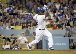 May 28, 2014; Los Angeles, CA, USA; Los Angeles Dodgers right fielder Yasiel Puig (66) hits a home run against the Cincinnati Reds during the sixth inning at Dodger Stadium. Mandatory Credit: Richard Mackson-USA TODAY Sports