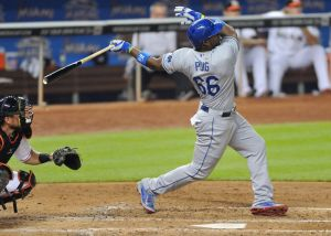 May 3, 2014; Miami, FL, USA; Los Angeles Dodgers right fielder Yasiel Puig (66) connects for a three run homer during the fourth inning against the Miami Marlins at Marlins Ballpark. Mandatory Credit: Steve Mitchell-USA TODAY Sports
