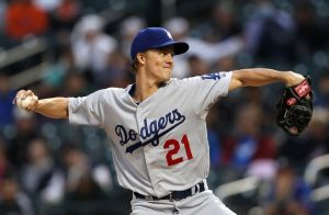 May 22, 2014; New York, NY, USA; Los Angeles Dodgers starting pitcher Zack Greinke (21) pitches against the New York Mets during the first inning at Citi Field. Mandatory Credit: Adam Hunger-USA TODAY Sports