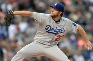 Jun 8, 2014; Denver, CO, USA; Los Angeles Dodgers starting pitcher Clayton Kershaw (22) prepares to deliver a pitch in the first inning against the Colorado Rockies at Coors Field. Mandatory Credit: Ron Chenoy-USA TODAY Sports